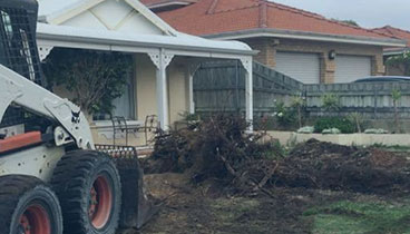 one of our hired bobcats clearing a house in perth