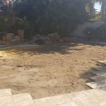 A filled in swimming pool with soil