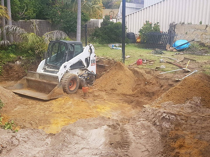 Swimming pool being removed with our bobcat